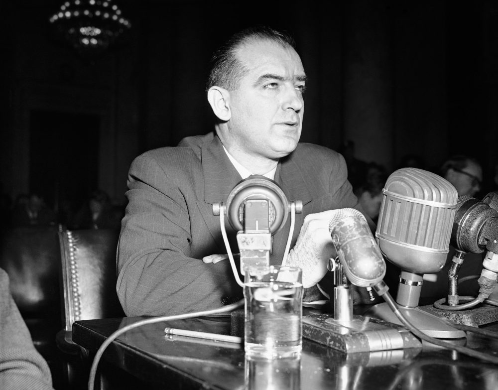 """Sen. Joseph R. McCarthy (R-Wisc.) testifies in Washington, March 8, 1950, before a Senate foreign relations subcommittee named to hear his charges that Communists have infiltrated the State Department. McCarthyism gave rise to a wave of anti-LGBT discrimination in government known as the """"lavender scare."""" (Herbert K. White/AP)"""