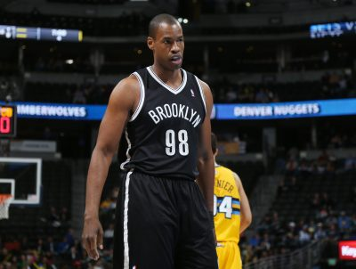 Jason Collins (98) takes the court in his third game as a Brooklyn Net on Thursday, Feb. 27, 2014. (AP Photo/David Zalubowski)