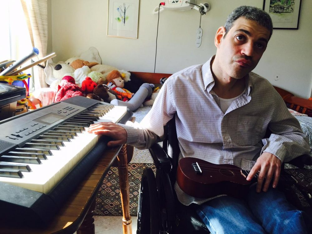 Henry Wein has cerebral palsy, and he lives in an apartment in Dover. The state provides round-the-clock care, which allows him to live in his own apartment. (Howard Weiss-Tisman/Vermont Public Radio)