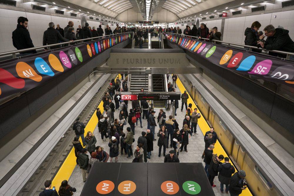 People walk about the newly opened Second Ave. Subway 86th Street station in New York Sunday, Jan. 1, 2017. (Craig Ruttle/AP)