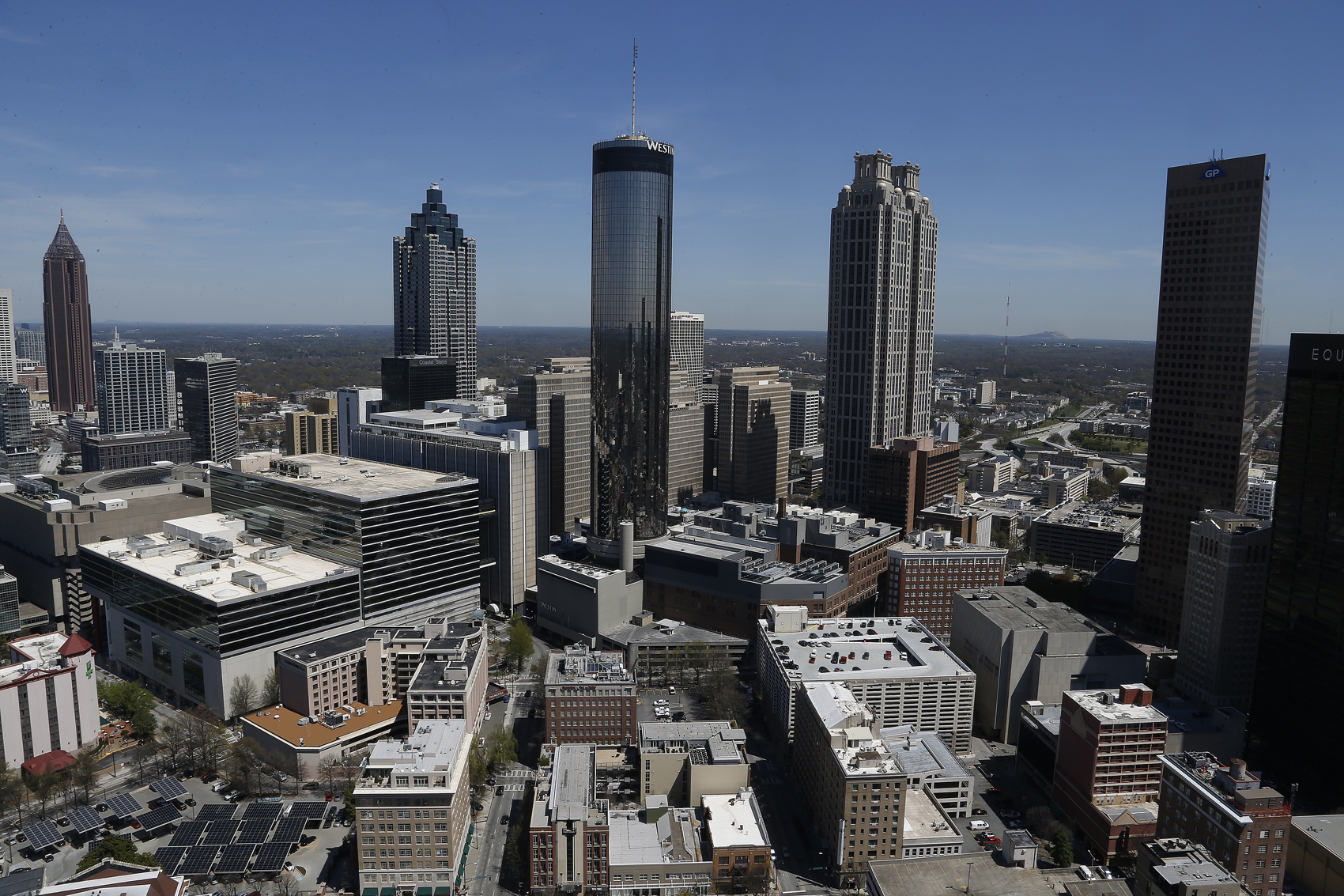 New York-based writer Reniqua Allen is noticing a new trend among black millennials — they're moving south. Pictured: The Atlanta skyline in 2014. (Mike Stewart/AP)