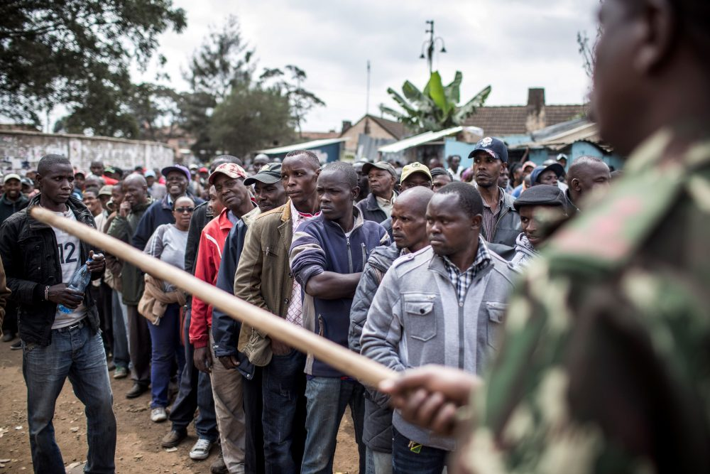 A Kenya Administration police officer holding a stick monitors access to a polling station at Kariokor Community Centre in Nairobi on Aug. 8, 2017 during general elections. Kenyans were voting in elections headlined by a knife-edge battle between incumbent Uhuru Kenyatta and his rival Raila Odinga that has sent tensions soaring in East Africa's richest economy. (Luis Tato/AFP/Getty Images)