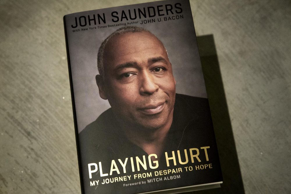 """Playing Hurt,"" by John Saunders, with John U. Bacon. (Robin Lubbock/WBUR)"