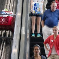 In this Aug. 21, 2015 photo, shoppers ride an escalator beside a special one for shopping carts in the CityTarget store in Boston. (Michael Dwyer/AP)