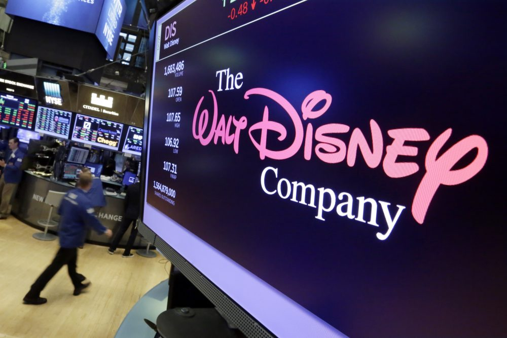 In this Monday, Aug. 7, 2017, photo, The Walt Disney Co. logo appears on a screen above the floor of the New York Stock Exchange. (Richard Drew/AP)