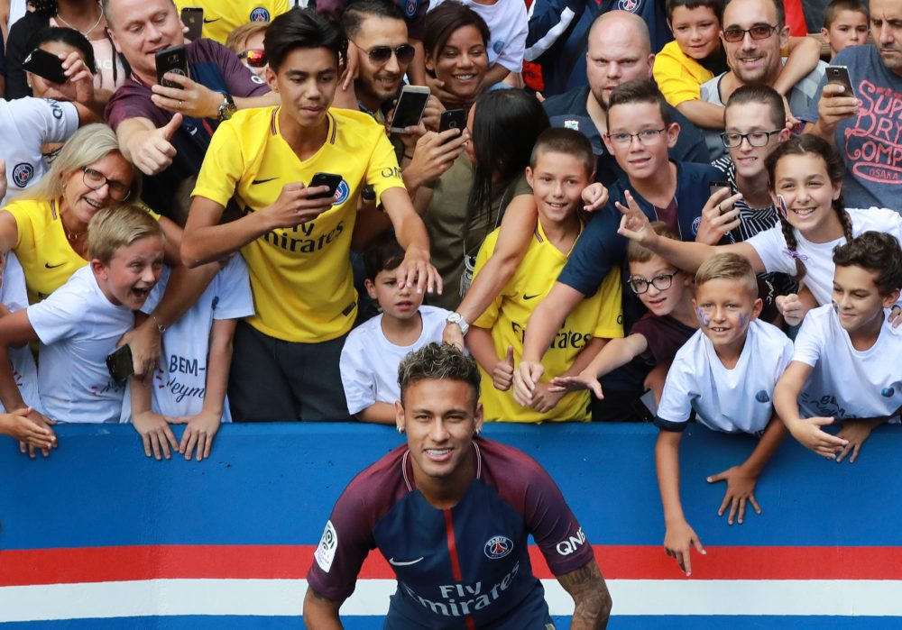 Brazilian superstar Neymar is presented to Paris Saint-Germain's fans after his record-breaking $263 million transfer from F.C. Barcelona. (Jacques Demarthon/AFP/Getty Images)