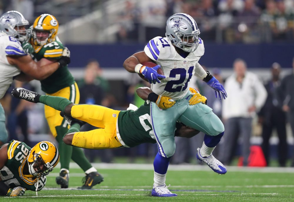 Ezekiel Elliott of the Dallas Cowboys carries the ball during the fourth quarter against the Green Bay Packers in the NFC Divisional Playoff game at AT&T Stadium on Jan. 15, 2017 in Arlington, Texas.  (Tom Pennington/Getty Images)
