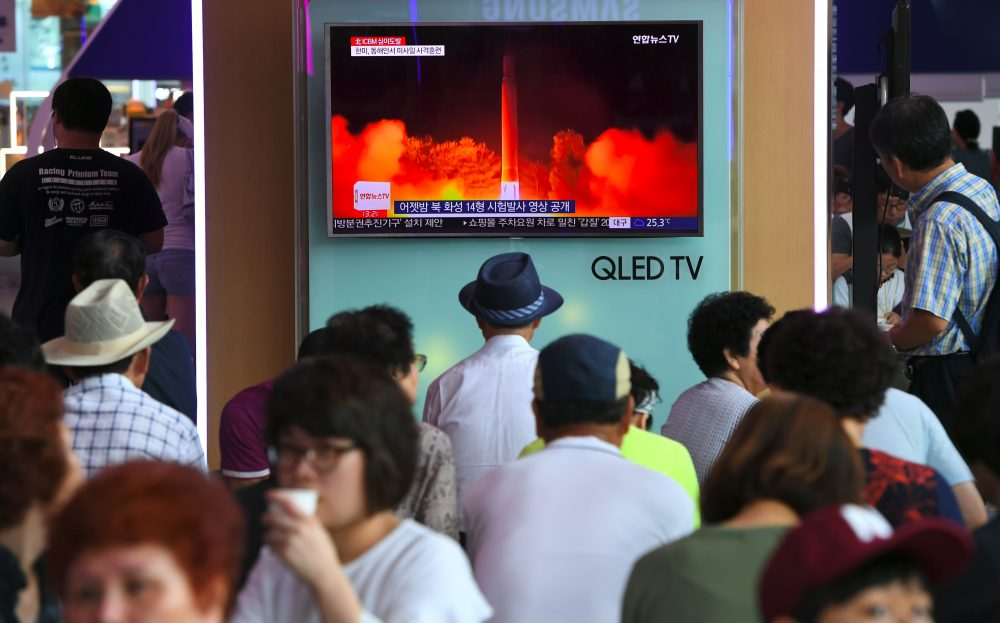 People watch a television screen showing a video footage of North Korea's latest test launch of an intercontinental ballistic missile, at a railway station in Seoul on July 29, 2017. (Jung Yeon-Je/AFP/Getty Images)