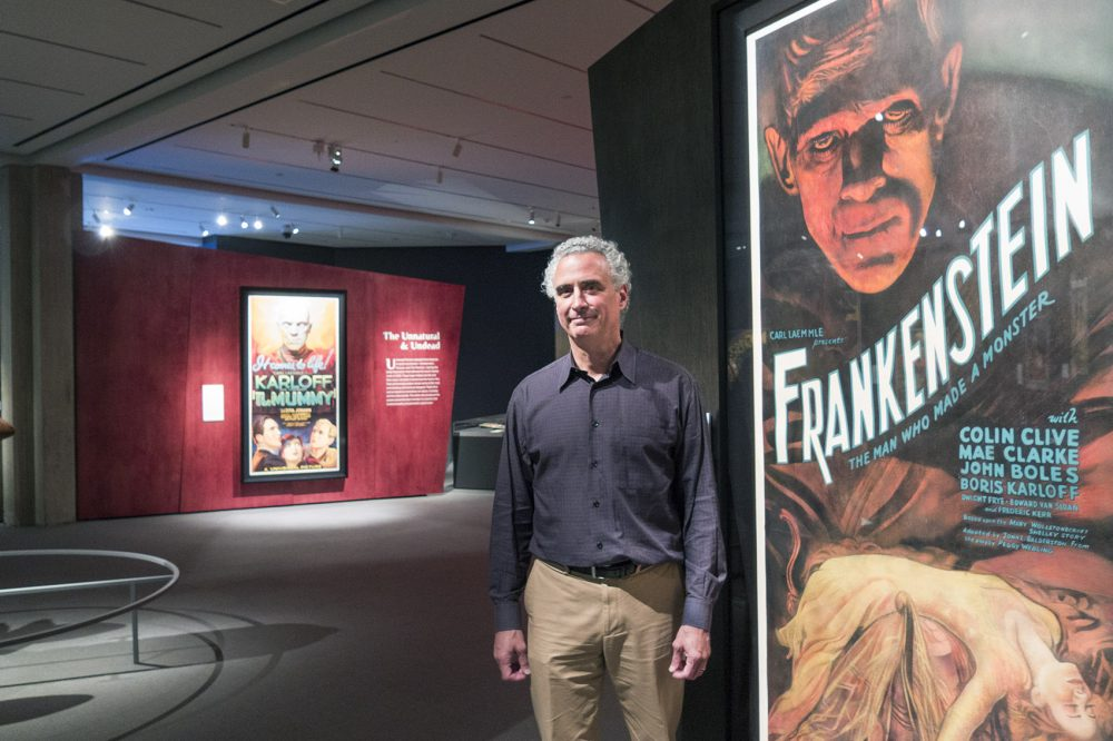 Peabody Essex Museum curator Daniel Finamore usually works with maritime art, but he was taken by Kirk Hammett's vast collection of rare horror and sci fi posters. (Andrea Shea/WBUR)