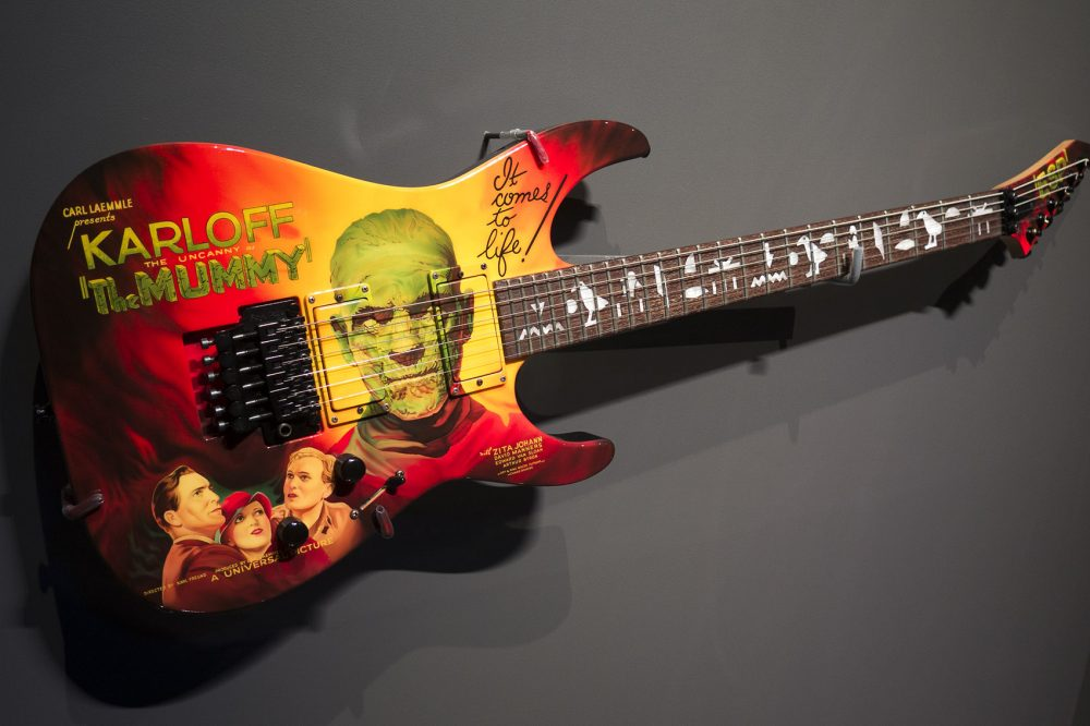 """Metallica guitarist Kirk  Hammett's  guitar with imprint from """"The Mummy"""" posters (and hieroglyphics on the neck. (Andrea Shea/WBUR)"""