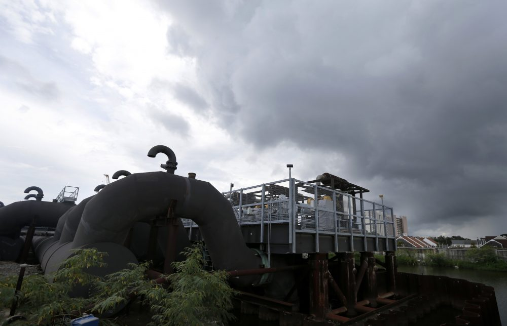 Rain clouds gather over the 17th Street Canal pumping station in New Orleans, Thursday, Aug. 10, 2017. With more rain in the forecast and city water pumps malfunctioning after weekend floods, New Orleans' mayor is urging residents of some waterlogged neighborhoods to move their vehicles to higher ground. (Gerald Herbert/AP)