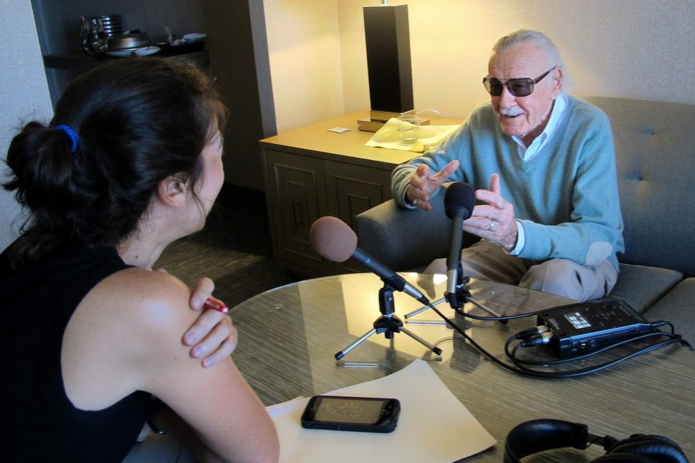 Comic book legend Stan Lee speaking with Shira Springer in Boston. (Max Anderson for WBUR)