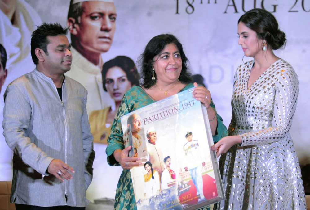 "Indian Bollywood actress Huma Qureshi (right) and film score composer and singer A.R. Rahman (left) take part in a promotional event for the forthcoming Hindi film ""Partition 1947"" directed by Gurinder Chadha (center) in Mumbai on July 4, 2017. (STR/AFP/Getty Images)"