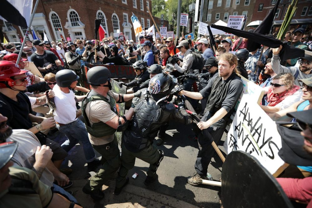 "White nationalists, neo-Nazis and members of the ""alt-right"" clash with counter-protesters as they enter Emancipation Park during the ""Unite the Right"" rally on Aug. 12, 2017 in Charlottesville, Va. (Chip Somodevilla/Getty Images)"