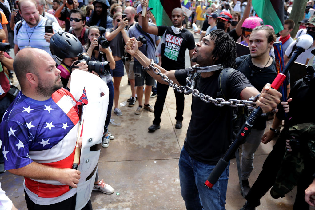 White nationalists, neo-Nazis and members of the 'alt-right' exchange insluts with counter-protesters as they attempt to guard the entrance to Emancipation Park during the 'Unite the Right' rally Aug. 12, 2017 in Charlottesville, Va. After clashes with anti-fascist protesters and police the rally was declared an unlawful gathering and people were forced out of Emancipation Park, where a statue of Confederate General Robert E. Lee is slated to be removed. (Chip Somodevilla/Getty Images)