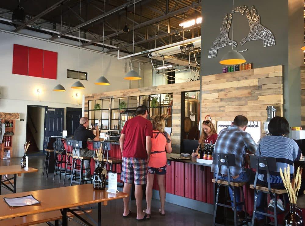 Inside Idle Hands Craft Ales taproom in Malden. (Pien Huang for WBUR)