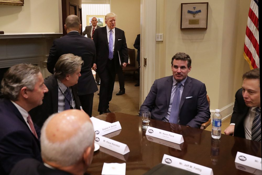 President Trump walks into the Roosevelt Room for a meeting with Mark Sutton of International Paper, Jeff Fettig of Whirlpool, White House Senior Counselor Steve Bannon, Kevin Plank of Under Armour, Elon Musk of SpaceX (left) and other other business leaders at the White House on Jan. 23, 2017 in Washington, D.C. (Chip Somodevilla/Getty Images)