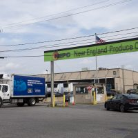 A delivery truck leaves the New England Produce Center in Chelsea. (Jesse Costa/WBUR)