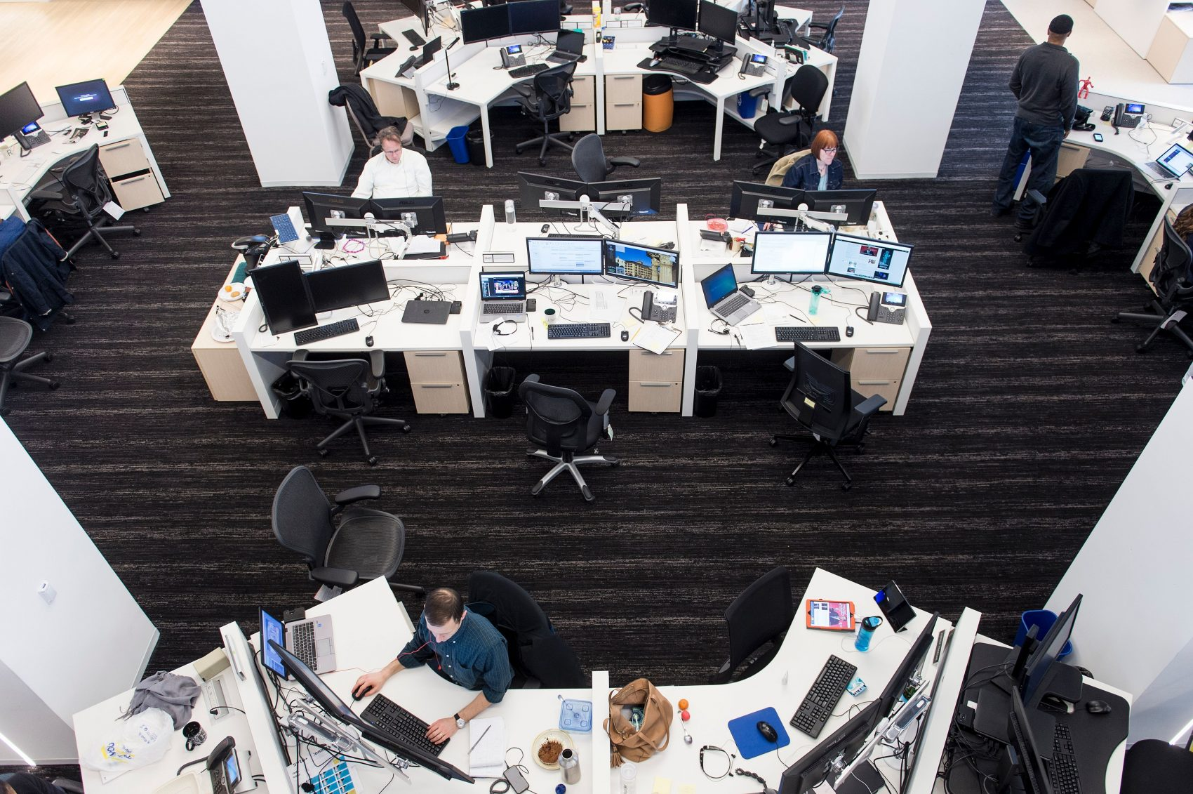 At the headquarters of the Washington Post, one journalist is using artificial intelligence to write the news. Pictured: The Post's newsroom in Washington, D.C. (Brendan Smialowski/AFP/Getty Images)