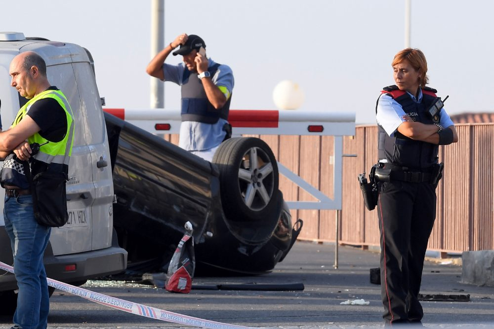 A policeman stands by a car involved in a terrorist attack in Cambrils, south of Barcelona, on Aug. 18, 2017. (Lluis Gene/AFP/Getty Images)