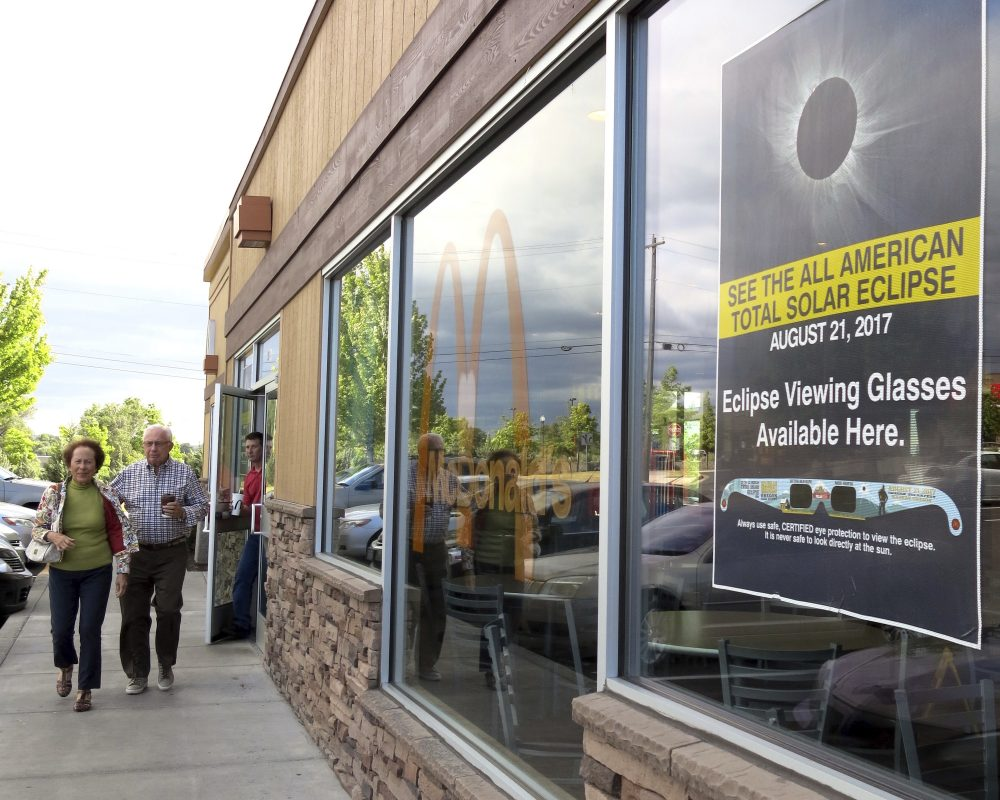 A poster advertising the Aug. 21 total solar eclipse hangs in the window of a McDonald's restaurant in Madras, Oregon on June 12, 2017. (Gillian Flaccus/AP)