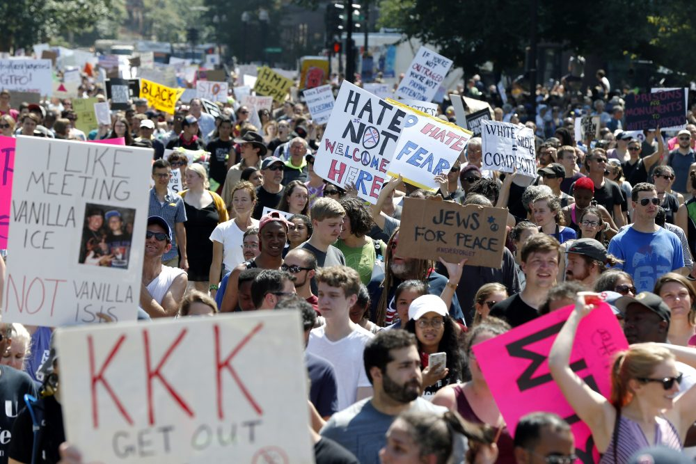 Counter-protesters stand on the periphery of the rally. (Michael Dwyer/AP)