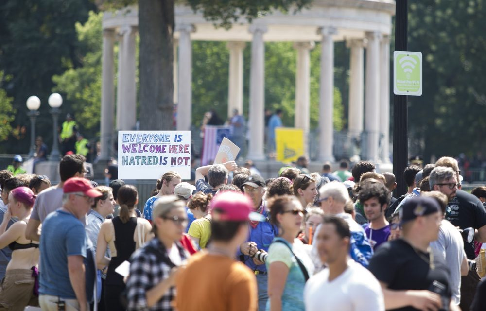Counter protesters amassed outside of the barriers at the Parkman Bandstand. (Jesse Costa/WBUR)