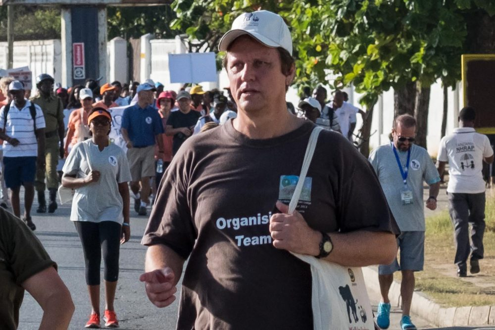 A picture taken on Jan. 14, 2017, shows South African conservationist Wayne Lotter taking part in the Walk for Elephants event endorsed by the Chinese embassy, in Dar es Salaam. Lotter, a leading conservationist who had worked hard to bring down notorious elephant poachers and stop ivory trafficking, has been shot dead in Tanzania, his PAMS foundation said on Aug. 20, 2017. (Daniel Hayduk/AFP/Getty Images)