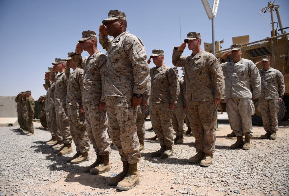 U.S. Marines salute during a handover ceremony at Leatherneck Camp in Lashkar Gah in the Afghan province of Helmand on April 29, 2017. (Wakil Koshar/AFP/Getty Images)