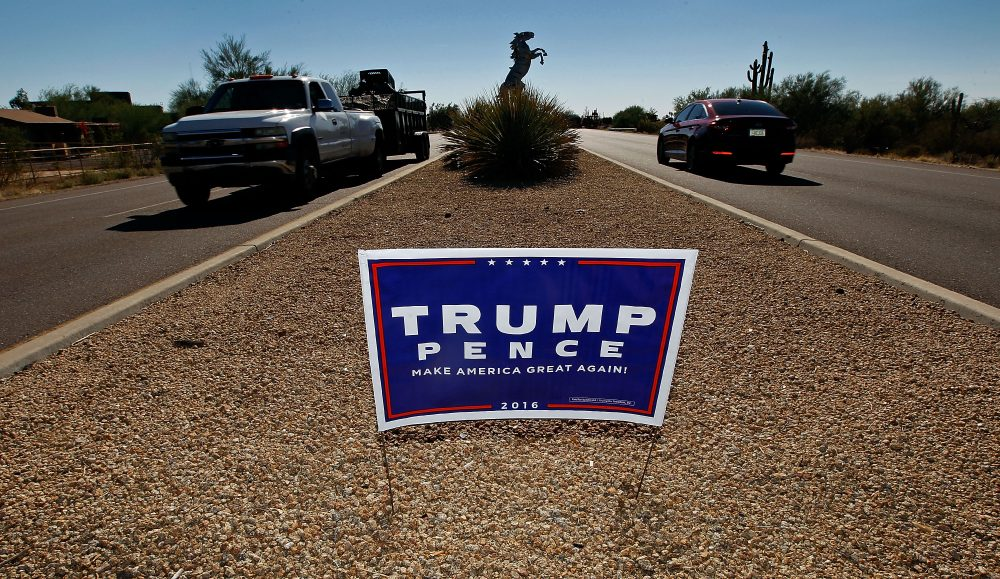 Motorists pass a campaign sign for then-Republican presidential candidate Donald Trump and vice presidential running mate Mike Pence posted in the center median of a roadway near a polling station on Nov. 8, 2016, in Cave Creek, Ariz. (Ralph Freso/Getty Images)