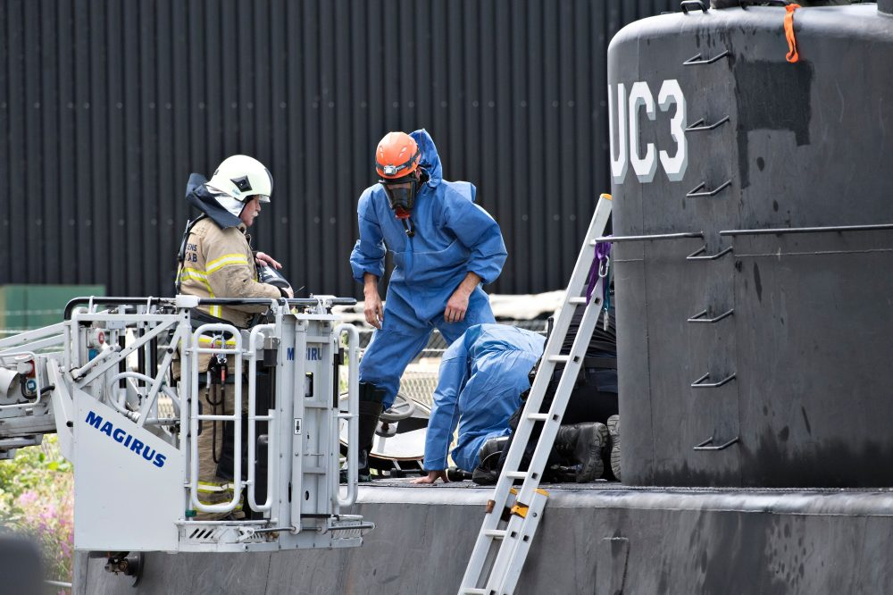 Police technicians investigate the rescued private-owned submarine UC3 Nautilus on Aug. 13, 2017 in Copenhagen Habor. Danish police said Sunday they searched a huge DIY submarine that sank last week in the hunt for a missing journalist who had been aboard before it sank, but no body was found. (Jens Noergaard Larsen/AFP/Getty Images)