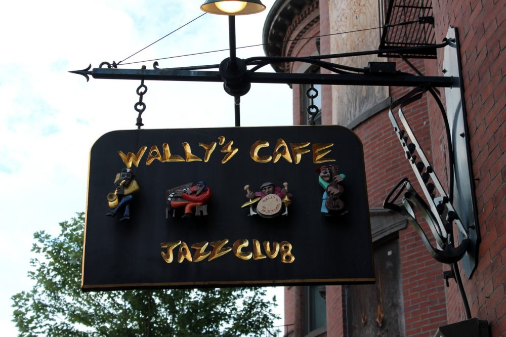 The sign outside of Wally's Cafe on Mass. Ave., discreetly curved into the shape of a saxophone. (Amy Gorel/WBUR)