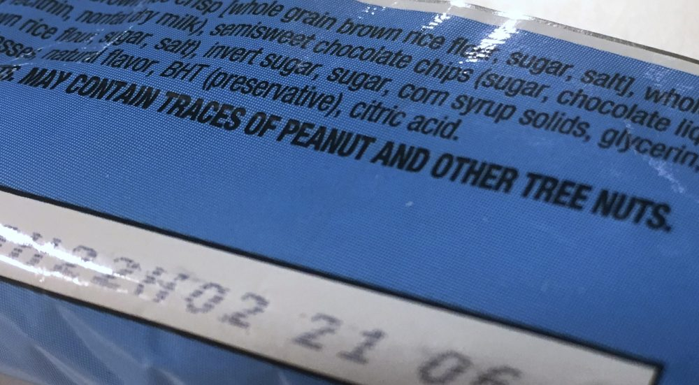 "This Nov. 30, 2016, photo shows part of a food label that states the product ""may contain traces of peanut and other tree nuts"" as photographed in Washington. (Jon Elswick/AP)"