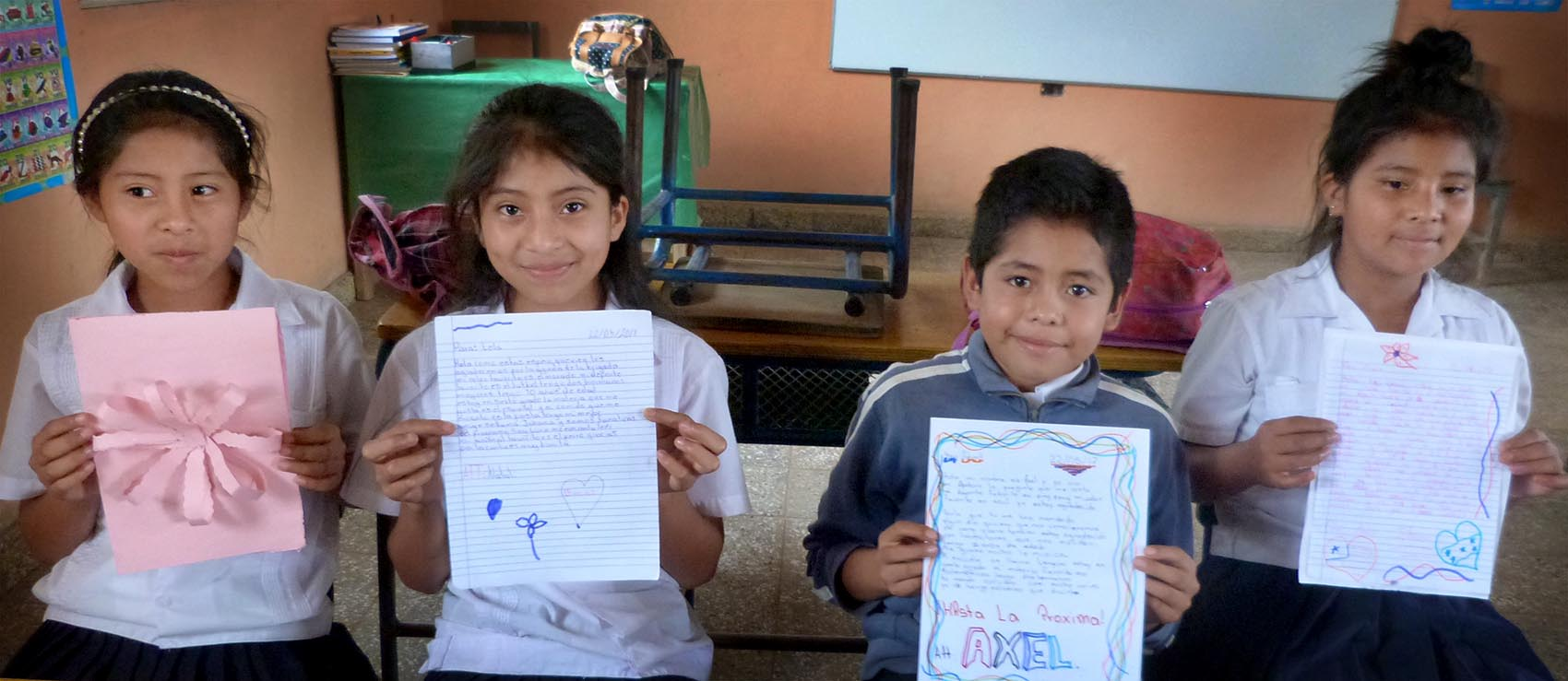 Lempira Elementary School students display their pen pal letter replies to Newtown students. (Karyn Miller-Medzon/Here & Now)