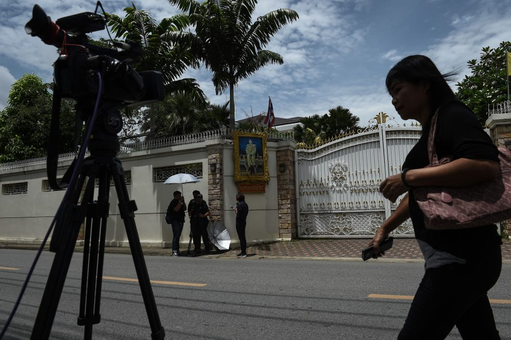 Members of the media film outside of the house of former Thai Prime Minister Yingluck Shinawatra in Bangkok on Aug 25, 2017. (Lillian Suwanrumpha/AFP/Getty Images)