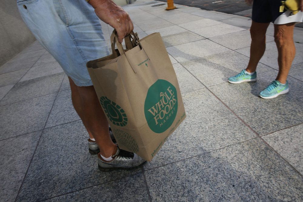 A customer carries his Whole Foods Market bag on May 10, 2017 in Miami. (Joe Raedle/Getty Images)