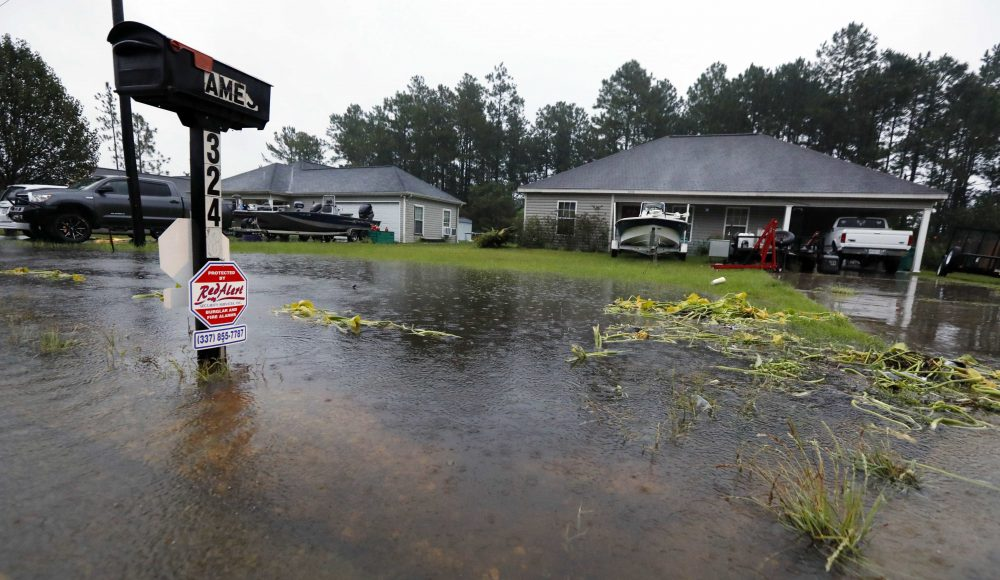Rising waters threaten homes along North Perkins Ferry Road in Moss Bluff, La., near Lake Charles, La., as a constant rain from Harvey falls. (AP Photo/Rogelio V. Solis)