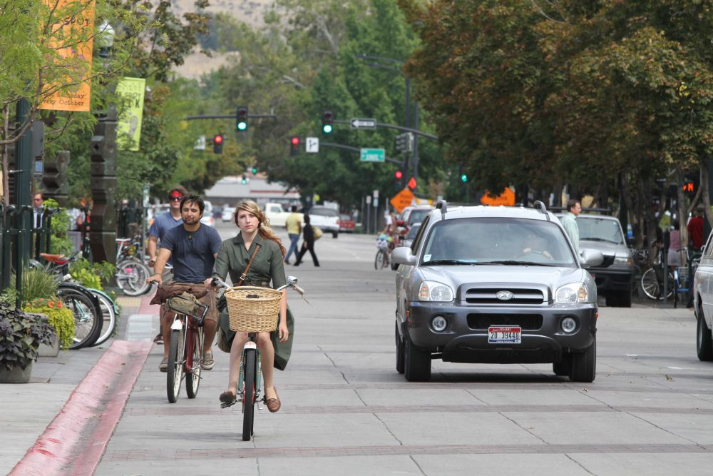 Bikers pedal through downtown Boise, Idaho, on Tuesday, Sept. 14, 2010. (Charlie Litchfield/AP)