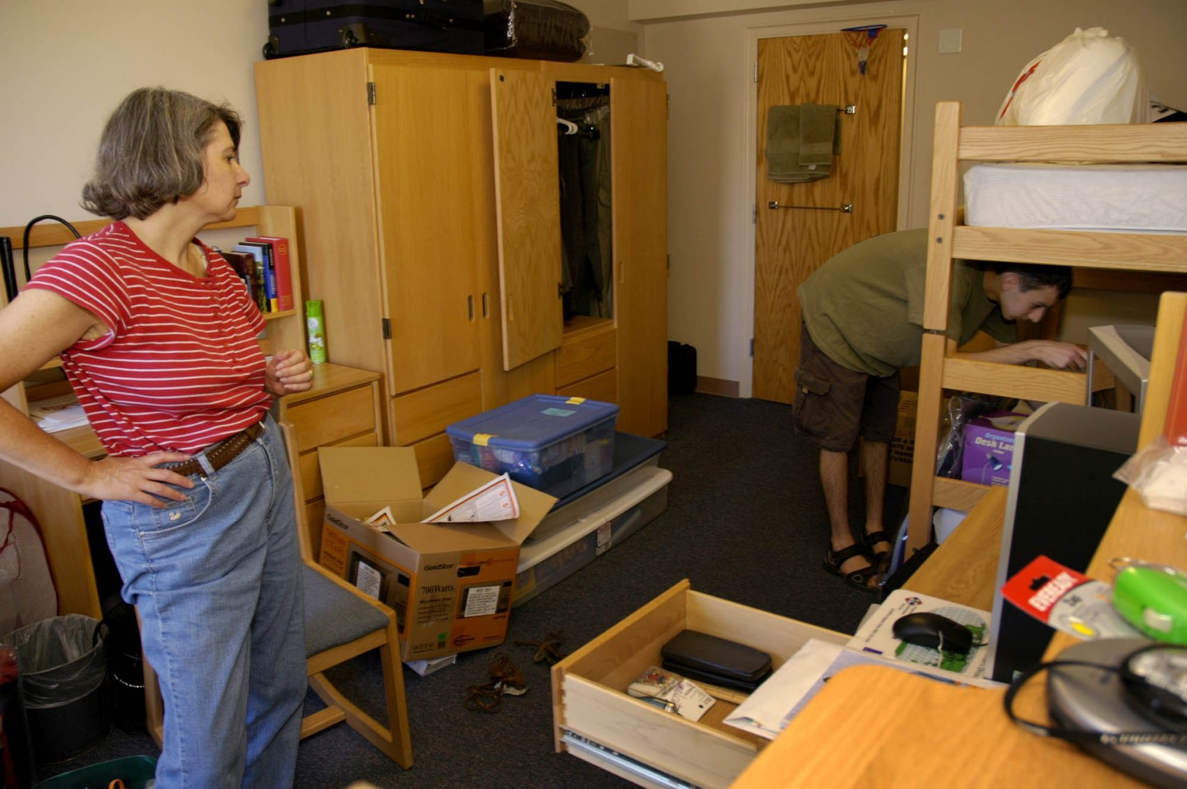 June Banker helps her son, Michael, move into his dorm room at Colgate University in Hamilton, N.Y., Thursday, Aug. 25, 2005. (Kevin Rivoli/AP)