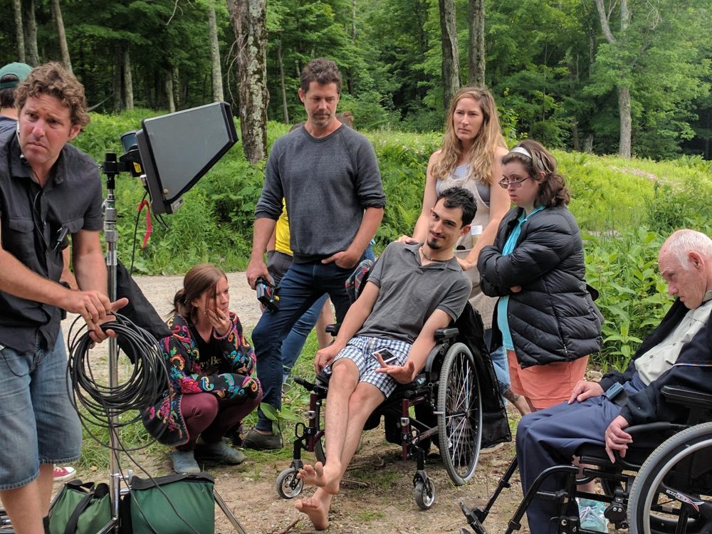 Campers at Zeno Mountain Farms spend a month living in wheelchair-accessible tree houses, performing, making films and taking care of one another. (Jon Kalish/For VPR)