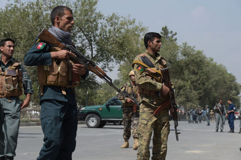 Afghan security personnel keep watch at the site of a suicide attack outside a bank near the US embassy in Kabul on August 29, 2017. (Shah Marai/AFP/Getty Images)