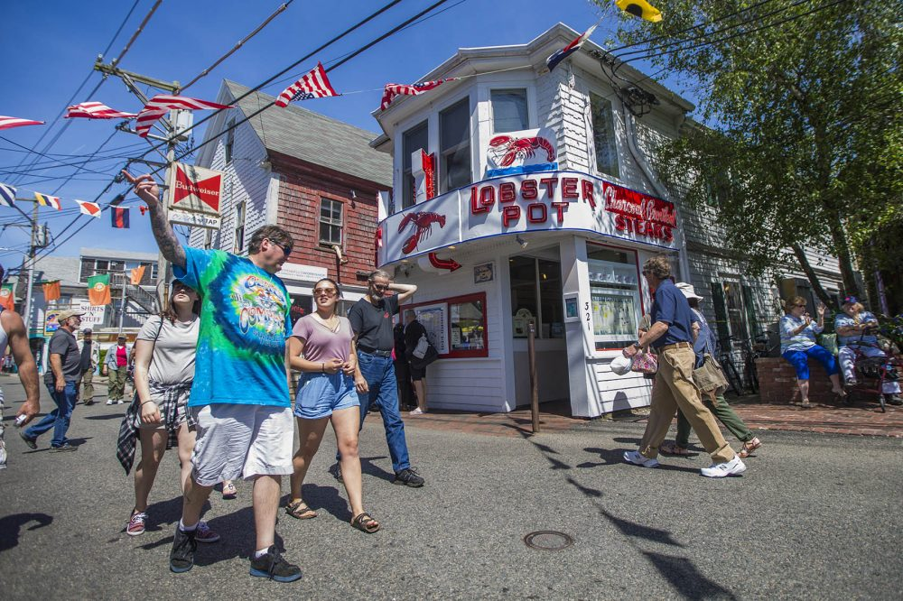 Tourists walk down Commercial Street in Provincetown. (Jesse Costa/WBUR)
