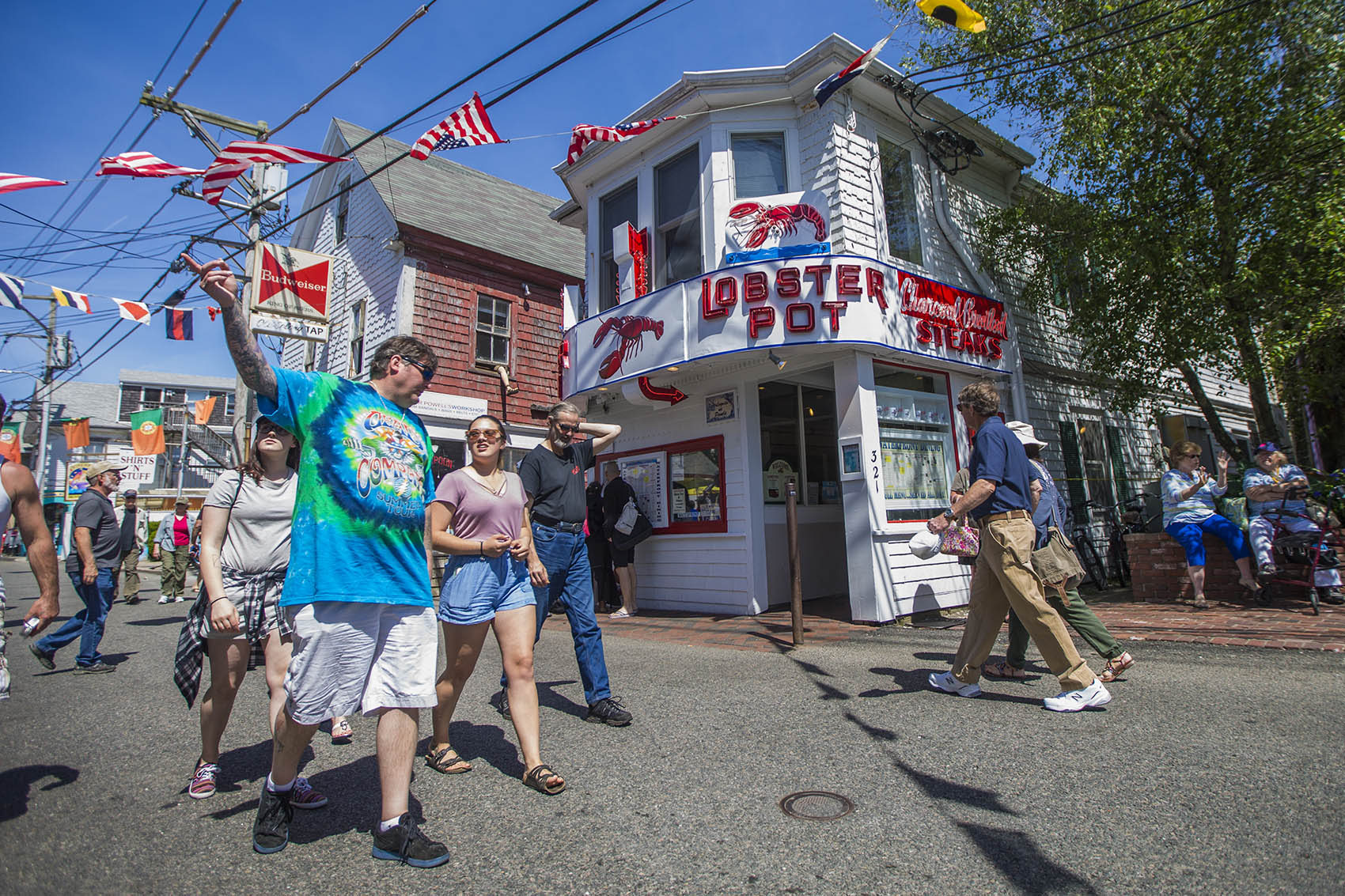 Tourists walk down Commercial Street in Provincetown. (Jesse Costa/WBUR)
