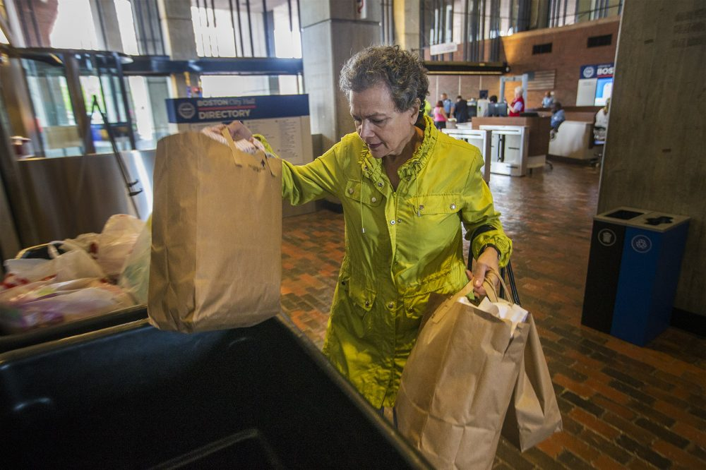 Diane Georgopoulos, of Cambridge, made a trip from home to Boston City Hall Tuesday to drop off supplies for the flood victims of Hurricane Harvey in Houston. (Jesse Costa/WBUR)