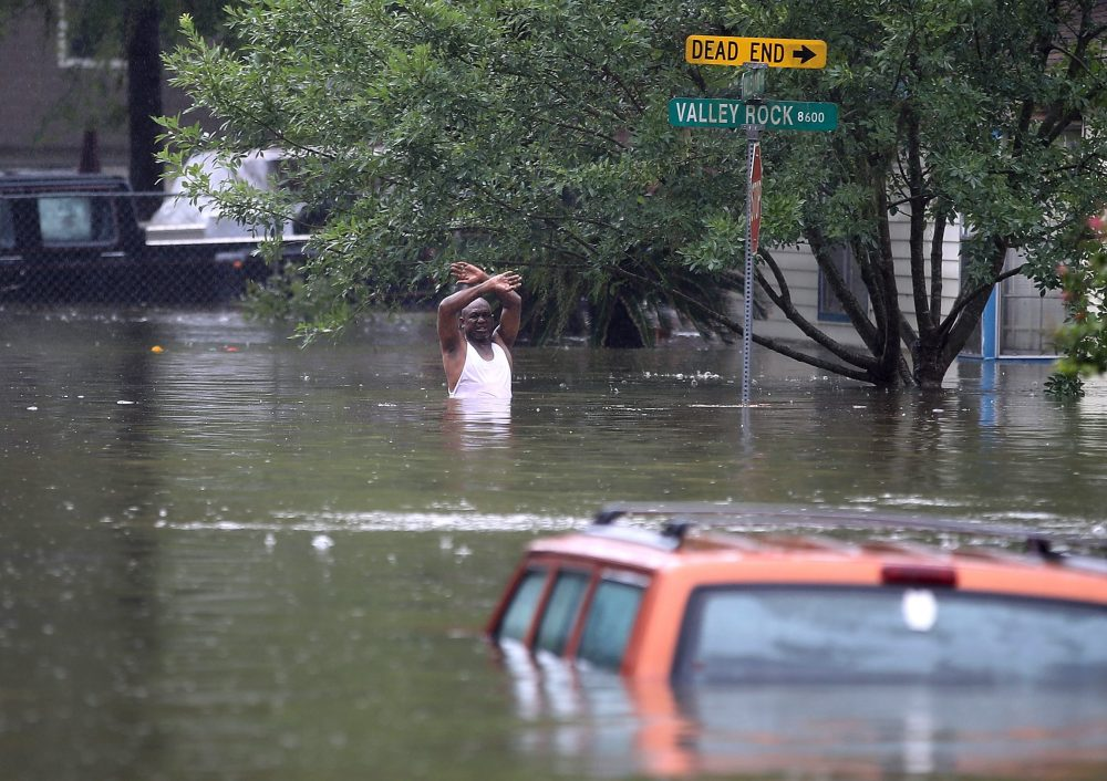 Jennifer and Randy Claridge's home has already been flooded twice before Harvey. Pictured: A man waves down a rescue crew as he tries to leave the area after it was inundated with flooding from Hurricane Harvey on Aug. 28, 2017 in Houston, Texas. (Joe Raedle/Getty Images)