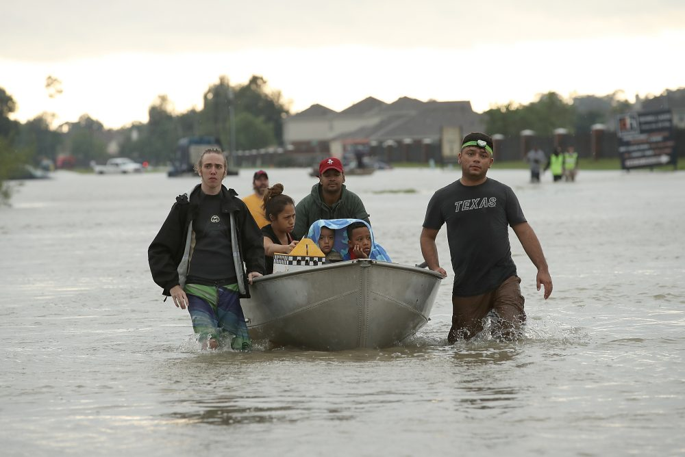 The Tellez family is evacuated from their home after severe flooding following Hurricane Harvey in north Houston Aug. 29, 2017. (Win McNamee/Getty Images)