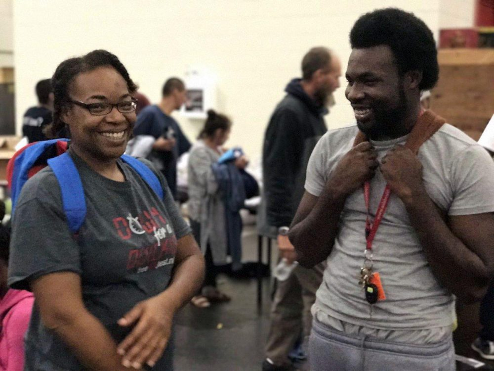 Demetrius Washington and his mother, Ramona, learn that his grandmother is safe Tuesday, Aug. 29 at the George R. Brown Convention Center in Houston. (Rachel Osier Lindley/KERA News)