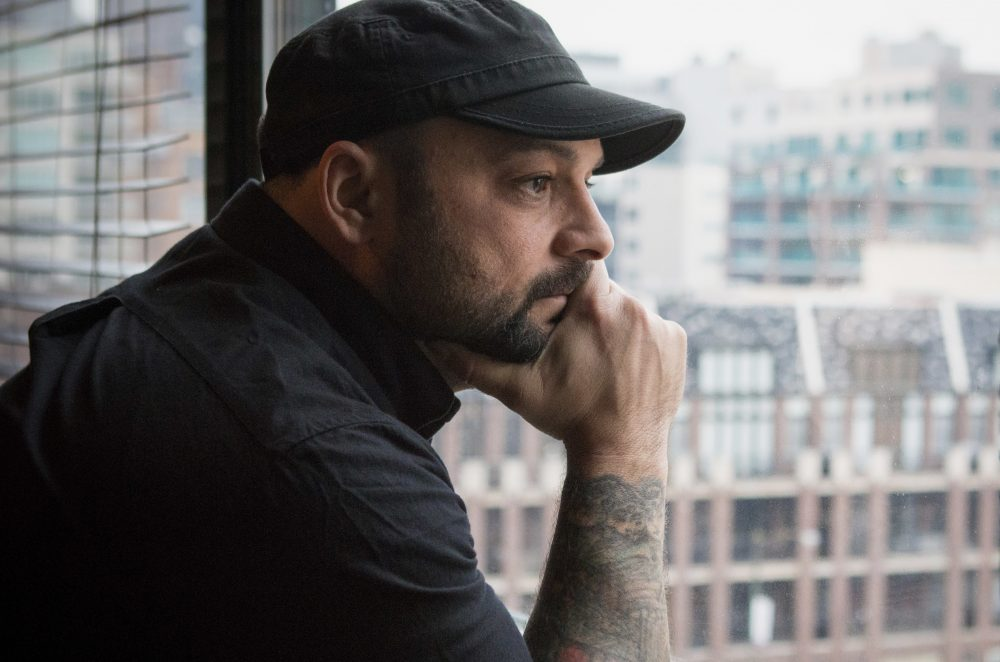 In this Jan. 9, 2017, photo, Christian Picciolini, founder of the group Life After Hate, poses for a photograph in his Chicago home. Picciolini, a former skinhead, is an activist combatting what many see as a surge in white nationalism across the United States. He's doing it by helping members quit groups including the Ku Klux Klan and skinhead organizations. (Teresa Crawford/AP)