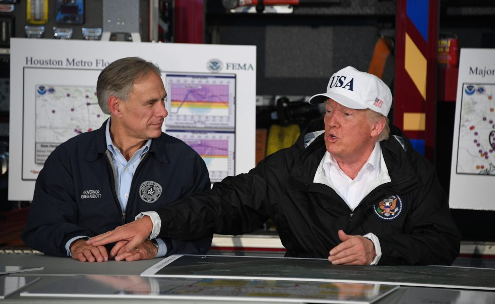 President Donald Trump (right) sits with Texas Gov. Greg Abbott during a briefing on Hurricane Harvey in Corpus Christi, Texas on Aug. 29, 2017. (Jim Watson/AFP/Getty Images)