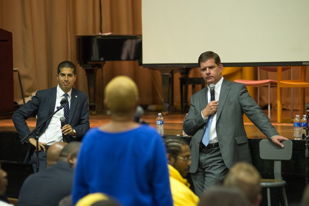 Dan Koh, then chief of staff to Boston Mayor Marty Walsh, and Walsh address Roxbury residents on May 20, 2014. (Courtesy Jeremiah Robinson/Mayor's Office)